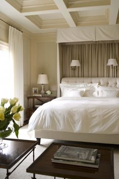 beautiful serene bedroom. Love the way they painted the coffered ceiling.