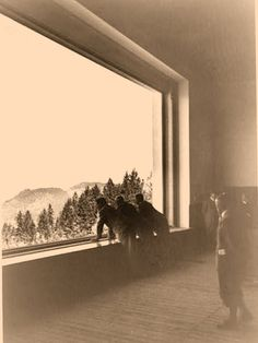 "Very rare photos taken by Eva Braun of the Great Room in the Berghof before any furniture was placed inside. This is some time in 1936, before the Berghof as ""move in ready."" Note the carpet hasn't been installed yet. The top photo clearly shows Hitler in profile (with visor cap) with Adolf Wagner, the Gauleiter of Munich. The bottom photo shows three men, the first of whom is Albert Speer.  Poor quality, but these are so rare."