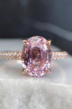 Unique pink diamond engagement ring with a gold pave diamond band. Pink Diamond Engagement Ring, Pink Diamond Ring, Beautiful Engagement Rings, Engagement Ring Styles, Antique Engagement Rings, Diamond Bands, Pink Diamond Wedding Rings, Pink Diamonds, Gemstone Engagement Rings