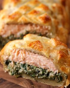 Puff Pastry Salmon Salmon Wellington Salmon Wellington This is an interesting concept could vary the ingredients for the mixture that goes inside goat cheese spinach and artichokes maybe Salmon Wellington Recipe, Wellington Food, Low Carb Vegetarian Recipes, Cooking Recipes, Healthy Recipes, Fish Dishes, Seafood Dishes, Seafood Platter, Fish Recipes