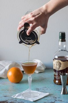 The Revolver, a bourbon cocktail with coffee liqueur and orange bitters. A spirit forward whiskey drink with subtle notes of coffee and citrus. via Blossom to Stem Mezcal Cocktails, Whisky Cocktail, Beste Cocktails, Cocktail Drinks, Fun Drinks, Yummy Drinks, Cocktail Recipes, Alcoholic Drinks, Beverages