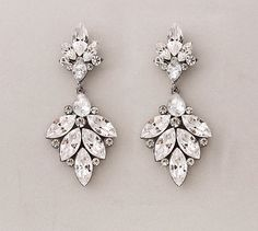 Swarovski Crystal Leaf Earrings - Shimmering crystals on antique silver settings.