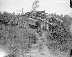 A Mark V tank which came to grief whilst clearing undergrowth. Near Chipilly, 10 August 1918.