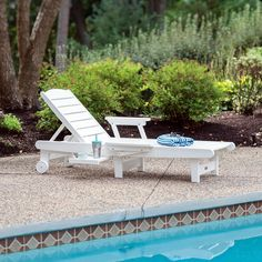 Deluxe Delray Chaise lounge with pull out tray table and folding arms...relax in style.