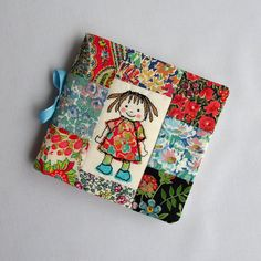 Needle case - Liberty Tana Lawn patchwork. Applique and machine embroidered doll on front
