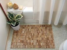 DIY wine cork bathmat - totally cute for a doormat or kitchen too :)  Tutorial here: http://www.craftynest.com/2010/03/wine-cork-bath-mat/