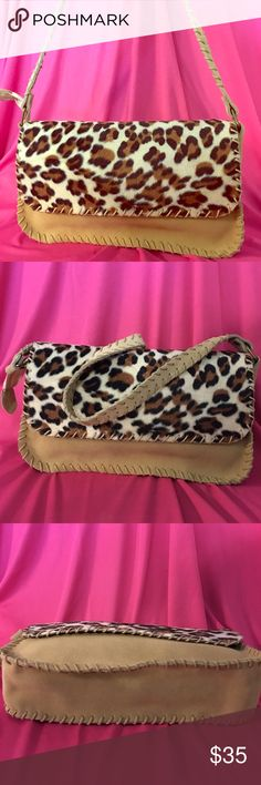 Leopard print suede leather bag 🎁Nwot Brand new . No tags. Genuine suede leather  handbag. So cute as a gift for the holidays . Zipper closure. Very stylish leopard print . Measures 11x6 inches . Fits your wallet, phone , sunglasses and keys comfortably. Ships fast!! boutique fashion Bags Shoulder Bags