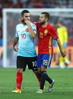 Jordi Alba of Spain and Arda Turan of Turkey in conversation during the UEFA EURO 2016 Group D match between Spain and Turkey at Allianz Riviera Stadium on June 17, 2016 in Nice, France.