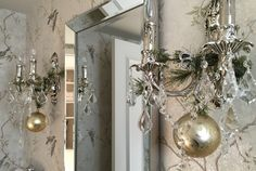 elegant powder room with evergreens and gold bauble on chandeliers Elegant Christmas Decor, Simple Christmas, Christmas Decorations, Bauble, Powder Room, Chandeliers, Party Planning, Oversized Mirror, Interior Design