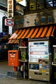 Deep Osaka : 関西を見る -  mobile, payphone and smokes all in one convenience store ---------- #japan #japanese