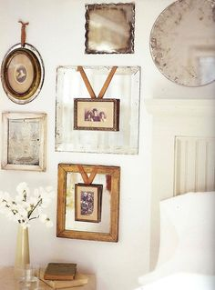 Mirrors. Hanging pictures in front of mirrors takes them up a notch. The brown ribbon with the brown frames ties the look together.