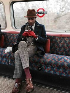 Most stylish man on the tube. (uploaded by u/pusew on reddit)