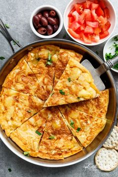 Spanish Omelette (Spanish Tortilla) is perfect served hot or cold, and so easy to make! Perfect for picnics, bbq's, or your Tapas menu!