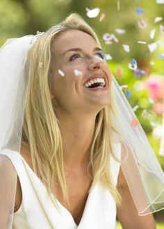 What Kind of a Wedding Dress Style Goes With a Blusher Veil?