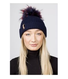 BKLYN Navy Bobble Hat With Blue/Red Pom: Luxury Italian merino wool bobble hat from BKLYN in Navy with Blue/Red pom pom. Ideal for the winter season and will add an element of style and fun to any outfit. The fine fibres blend and feel gentle next to your skin and kind on your hair, the raccoon fur Pom Pom is uniquely coloured to each hat and detachable via a metal popper.