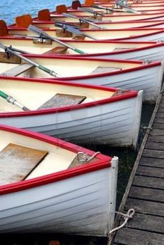 Row of docked wooden rowing boats