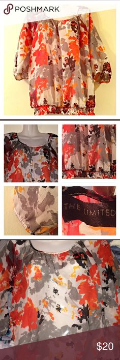 The Limited Blouse Beautiful semi sheer color splash patterned blouse. Colors of orange, red, gray, burgundy, cream, and black. Hem has elastic  gathering. The Limited Tops Blouses