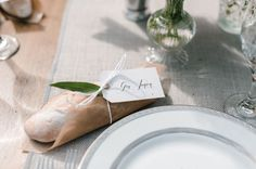 Here's a cute idea for at each place setting. bread plate setting