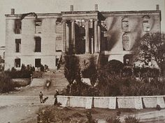 Original Capitol building as it appeared after it burned on Nov. 9, 1881.