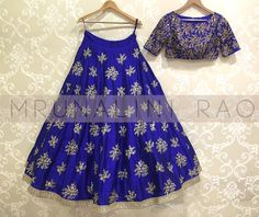 Royal blue flower bunch lehengaDrop by Mrunalini rao studio in Hyderabad to take a look at our bridal collection. Call us on +91 7032083620 for orders and queries. 21 March 2017