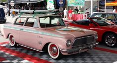 It is #throwbackthursday : Here is a 1963 Ramlber American Custom 3 speed car, that we saw at the #barrettjackson #auction #PalmBeach .  This car with its cool retro custom paint and pin striping with surfboards attracted quite a crowd when it was on display, yet it only bid up to $7000 on the auction block, plus a 10% buyer's premium.  #tbt #tbthursday #rambler #nashrambler #barrettjacksonauction Barrett Jackson Auction, Surfboards, Custom Paint, Palm Beach, Cool Cars, Crowd, Antique Cars, Display, Retro