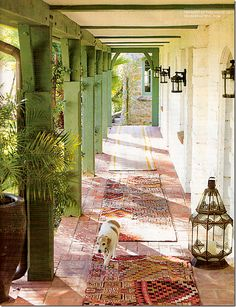 covered walkway- love the bricks and the rugs. must not rain much here since this is open to the gardens