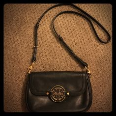 Tory Burch black Amanda cross body handbag Black leather cross body with gold accents, perfect going-out purse! No flaws or scratches in the leather, but some of the gold has worn off in various places, mainly what is shown in last picture. Tory Burch Bags Crossbody Bags