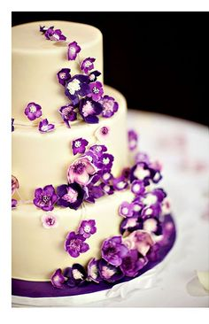 Purple Flowers on Ivory Wedding cake