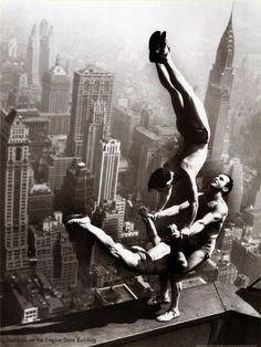 Empire State Building.  Three guys in an undertaking that OSHA would not condone.  No fall protection.