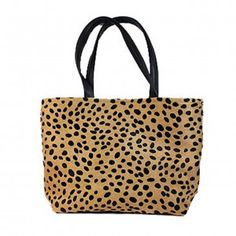 """Cheetah Stamped Hair on Cowhide Tote. Dark brown leather handles. Interior with 3"""" leather top and beautiful turquoise and green cotton batik lining One leather zippered interior pocket and 2 open hand beaded, fabric pockets. Leather strap with brass toggle for easy to find keys. Magnetic closure. 18""""wide x 12"""" high with 5"""" soft bottom."""