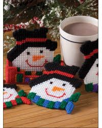 """Different colored scarves make each of these cozy coasters unique. when not in use, they tuck away tidily in a handy holder.<BR \> <BR \> Coasters 4 3/8"""" X 4 3/8""""<BR \> Coaster Holder 4 1/2"""" X 1 1/2"""" X 1 3/8"""""""