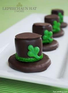 St. Patrick's Day dessert DIY. Glittering shamrocks adorn a Leprechaun Hat, made of s'mores! A festive and fun DIY for St. Patrick's Day. Created by Carrie Sellman.
