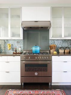 Paisley wallpaper on this kitchen backsplash makes for a fun and unique look: http://www.bhg.com/kitchen/backsplash/backsplash-pairings/?socsrc=bhgpin061014playingwithpattern&page=11