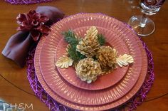 She gently pours bleach over her pinecones and soaks them overnight. The end result is gorgeous fall table decor:
