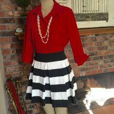 Bandage material Skirt zip and stretch B&W Sz Lrg on tag, med in fit. Perfect with a red shirt for the holidays Skirts Mini