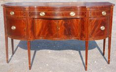 The use of the floral and fine circular line inlay in the drawer fronts gives further reference for this sideboard being made in Baltimore, by a master craftsman, and for a wealthy client. Description from eamackantiques.com. I searched for this on bing.com/images