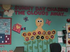 """Sesame Street theme classroom: """"Sunny day chasing the clouds away!"""" Each child made a flower out of coffee filters and water color paint. Big bird board"""