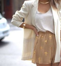 Love!! White opened jacket and gold accentuated cross shorts. ::M::