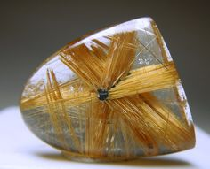 Rutile star in Quartz;  Asterated Quartz exhibits the pattern of a starlike luminous figure on the surface of the stone, during conditions of transmitted light-the phenomenon is due to minute oriented acicular inclusions. It has been used in communication with those of the stars, bringing information with respect to life, culture, advancement in technology and advanced healing methods.