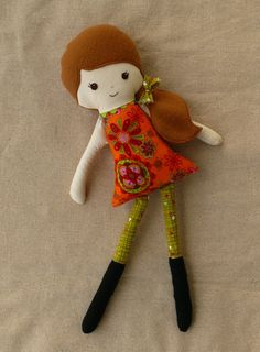 I really love rovingovine's dolls on etsy!!