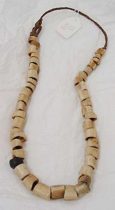Oceanic - Necklace, bone & cotton, mid-20th century