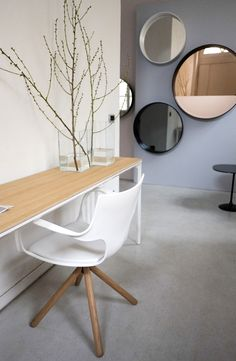 The Slim wood console and the Flute chair with wooden base. The ideal space to work and study in your home spaces.