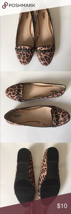 leopard print flats with round gold studs super cute leopard print flats, only wore once (indoors only). some how they did get a small scuff of inner part of front left shoe. otherwise like new. they run a little narrow for me so they didn't work out sadly. Mossimo Shoes Flats & Loafers