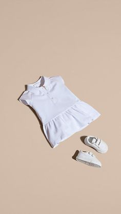 A white Burberry dress for warm-weather days in cooling stretch cotton piqué with soft cap sleeves and a dropped waist. Unbutton the placket to reveal our signature check. Burberry Kids, Burberry Dress, White Shoes For Girls, Selfies, Clothing Photography, Kids Fashion, Fashion Clothes, Baby Kids Clothes, Little Dresses