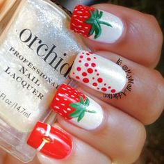 Strawberry motif on nails.