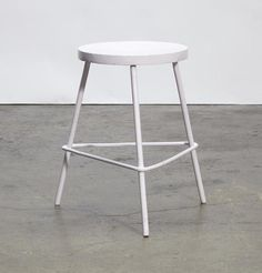 Pierre Jeanneret  Stoolcirca 1960painted wood and tubular metalheight 18 3/4in (47.5cm); diameter 12in (30cm)