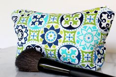 Whether youre looking for the perfect gift for a birthday, bachelorette party or bridal shower, or something for yourself, this green and blue mosaic tile travel set is perfect for any makeup lover! It includes a flat bag (photos 3-6), tall bag (photos 1-2), and round bag (photos 7-8) to hold all your essentials.  Made from cotton fabric, these vibrant bags are easy to carry and care for. Dimensions:  Flat Bag: 8.5 x 5.5 inches Round Bag: 9 x 4 x 1.25 inches Tall Bag: 7 x 2 x 4 inches  Care…