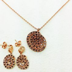 Snail Earrings + Necklace Fashion Jewelry Set, Rose Pink with cocktail Color Cubic Zirconia, Made In Korea @ https://www.gokoco.com/gkc/fashion-jewelry/sets/snail-earrings-necklace-fashion-jewelry-set-rose-pink-with-cocktail-color-cubic-zirconia-made-in-korea.html