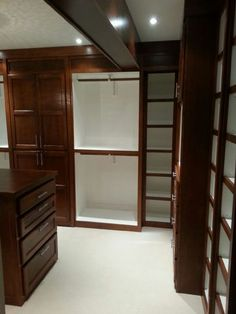 Stained Walk In Closet Custom Built with everything imaginable by Woodmaster Woodworks