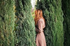 What does she see on the other side of the fence that she had lived behind for…